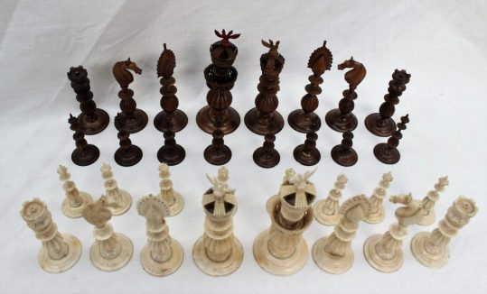 A 19th century Anglo Indian ivory chess set, natural and stained brown, on turned and melon shaped bases, with carvings and pierced decoration, King 12cm high, Pawn, 6.5cm high. Sold for £1,400 at Anthemion Auctions