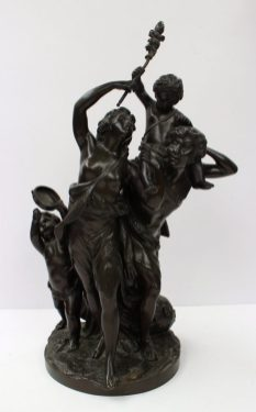 After Clodion: A Bronze Classical Family Group, of a young man wearing fur wrap and semi-nude woman with two infants, one playing the tambourine, on a rustic oval base, bearing signature, 46cm high. Sold for £900 at Anthemion Auctions