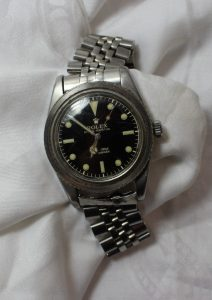 """A gentleman's Rolex Submariner bracelet watch, with a circular black dial, luminous hour markers and silver/luminous hands and seconds sweep, the dial inscribed """"Rolex Oyster Perpetual 100m=330ft Submariner Swiss T 25"""" to a stainless steel case (bezel missing) to an oyster link style bracelet. Model number 6536-1, case reference 306396,. Sold for £4,200 at Anthemion Auctions"""
