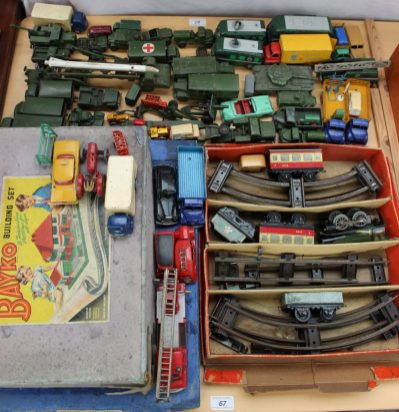 A Hornby Train Goods Set No.20 comprising and O gauge clockwork 0-4-0 locomotive and tender No.60985, with carriage and track, boxed, two bayko construction sets and a quantity of Dinky military vehicles, Corgi trucks etc. Sold for £370 at Anthemion Auctions