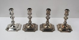 A set of four Elizabeth II Britannia standard silver candlesticks with knopped stems on square bases, London, 1967, Wakely and Wheeler, approx. 1650 grams. Sold for £1,000 at Anthemion Auctions
