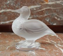 A Crystal Lalique model of a duck on a circular base, marked Lalique France, 12cm high. Sold for £65 at Anthemion Auctions