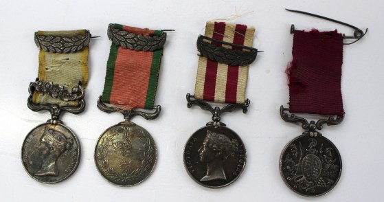 A set of four Victorian medals including Crimea medal with Sebastopol bar issued to W. Thomas, Gr.RL. horse art, Turkish La Crimea 1855 medal not inscribed, India mutiny 1857-1858 medal issued to Gunner Wm Thomas, F Tp, R H Arty and a Long Service and Good Conduct Medal issued to Sergt W Thomas B BDE RHA, together with a postcard photograph of the family including him wearing the medals, a watercolour of W Thomas on horseback dated 1854 and other ephemera. Sold for £900 at Anthemion Auctions
