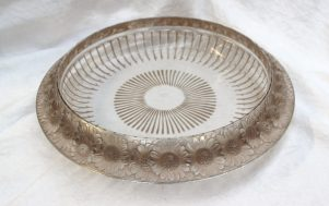 A Lalique marguerites pattern glass bowl, moulded with daisies to the rim , the base with line decoration stencilled Lalique, France, 36cm diameter. Sold for £310 at Anthemion Auctions