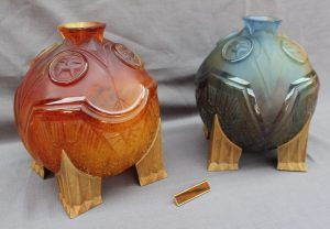 """A pair of Daum """"Salammbô"""" vases for night and day in moulded thick glass in purple and amber on gilt bronze feet, signed and numbered """"Druillet-Daum France 38/90 and 26/90."""", 27 cm high with certificates and boxes. Sold for £4,500 at Anthemion Auctions"""