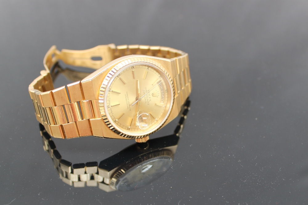 "A gentleman's 18ct yellow gold wristwatch, the yellow metal dial with batons, day and date marked ""Rolex oyster quartz Day-Date, superlative chronometer"" marked to the reverse 19018, 6405298 (no box or paperwork). Sold for £3,900 at Anthemion Auctions"