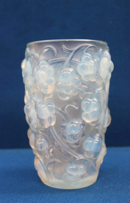 "A Rene Lalique "" Raisins"" pattern vase thickly moulded with high relief grapes on vines motif around the exterior, marked to the base R Lalique, France, 15.8cm high. Sold for £700 at Anthemion Auctions"