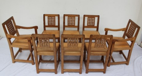 """Robert Thompson of Kilburn, """"Mouseman"""" - A set of eight light oak dining chairs with lattice back and studded seat on carved legs and square section feet, each carved with the trademark mouse, includes two carvers (8). Sold for £2,400 at Anthemion Auctions"""