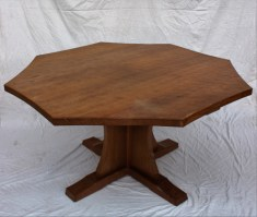 "A Robert Thompson of Kilburn ""Mouseman"" octagonal topped dining table with an adzed top and concave side on a quatrefoil base and tapering legs carved with his trademark mouse, 133.5cm wide x 74cm high. Sold for £680 at Anthemion Auctions"