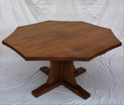 """A Robert Thompson of Kilburn """"Mouseman"""" octagonal topped dining table with an adzed top and concave side on a quatrefoil base and tapering legs carved with his trademark mouse, 133.5cm wide x 74cm high. Sold for £680 at Anthemion Auctions"""