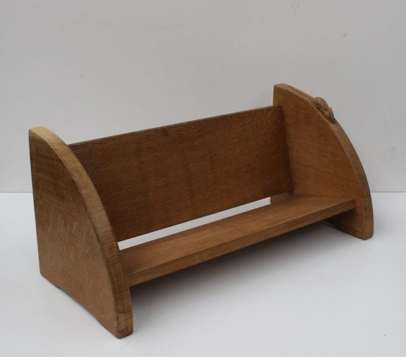 """Robert Thompson of Kilburn """"Mouseman"""" book trough, with trademark mouse carved facing downwards, 45cm, wide. Sold for £170 at Anthemion Auctions"""