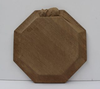 "A Robert Thompson of Kilburn ""Mouseman""octagonal cheese board, with trademark mouse on the outside edge, 19cm wide. Sold for £85 at Anthemion Auctions"