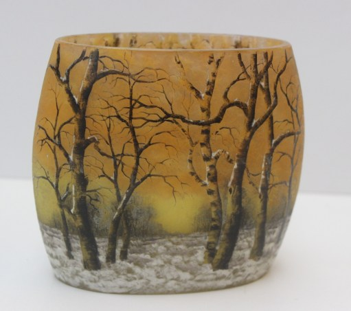"""A Daum """"Winter Landscape"""" vase, the mottled orange and yellow ground etched and enamelled with trees in a snowy landscape, black painted mark, """"Daum, Nancy"""" and cross of Lorraine, 12cm high. Sold for £1,100 at Anthemion Auctions"""