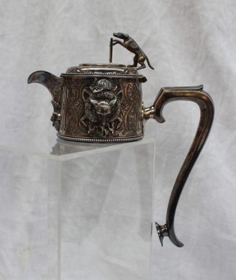 A Victorian silver claret jug top, the top with a hound jumping a fence, the body cast with a fox mask, brush and whips, Sheffield, 1871, Martin, Hall & Co (Richard Martin & Ebenezer Hall), approximately 480 grams (the weight includes the top of the broken glass liner and fixative, so does not reflect the silver weight). Sold for £300 at Anthemion Auctions