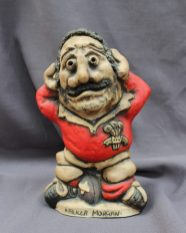 "A John Hughes pottery Grogg titled ""Mauler Morgan"", in a Welsh jersey with his arms behind his head, the number 2 on his shirt, signed to the reverse, 26cm high. Sold for £120 at Anthemion Auctions"