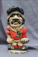 "A John Hughes pottery Grogg of ""Tail end Thomas"", in a red Welsh jersey with the No.8 on the reverse, Signed to the base, 32cm high. Sold for £130 at Anthemion Auctions"