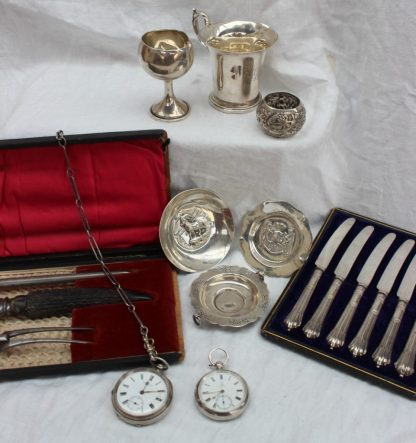 A late Victorian silver open faced pocket watch, the enamel dial with Roman numerals and a seconds subsidiary dial, inscribed ROBt Curtis, Hull, 1899, Chester together with another silver open faced pocket watch, silver Albert Chain, silver handled knives, silver christening mug, napkin ring, dishes, carving set etc weighable silver approximately 210 grams