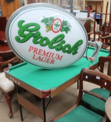 A Grolsh advertising sign together with a pool table etc