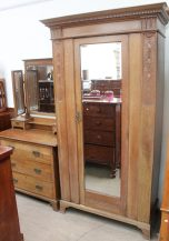 An Edwardian oak wardrobe with matching dressing table