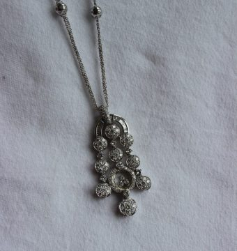 A diamond necklace set with baguette and brilliant cut diamonds to a white metal setting and chain with diamond set balls, believed to be by Chopard, but unmarked, overall weight approximately 29.5 grams. Sold for £1,750 at Anthemion Auctions