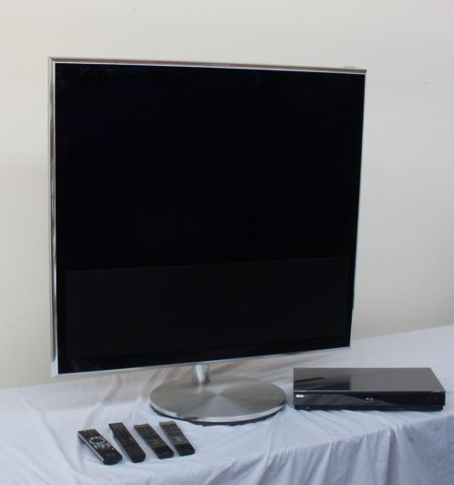 A Bang & Olufsen Beovision 11-40 all black flat screen television, with motorised floor stand, BE04 remote control, and cables, purchased 12-2-2014 for £6400.00 together with a Sony BDP-S760 blu ray disc/dvd player. Sold for £1,100 at Anthemion Auctions