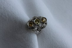 A diamond dress ring, set with three fancy yellow round brilliant cut diamonds, the central stone approximately 0.75 of a carat, with two others approximately 0.5 of a carat, the raised basket setting set with round brilliant cut diamonds to an 18ct white gold setting and shank, size M 1/2, approximately 11.2 grams. Sold for £1,000 at Anthemion Auctions
