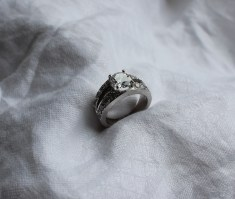 A diamond dress ring, the central round brilliant cut stone approximately 1.5 carats to two lines of eight round brilliant cut diamonds to a white metal setting and shank, size K 1/2, approximately 9.5 grams. Sold for £3,500 at Anthemion Auctions