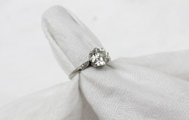 A solitaire diamond ring, the round old cut diamond approximately 1.5 carats to a white metal claw setting and shank. Sold for £3,400 at Anthemion Auctions