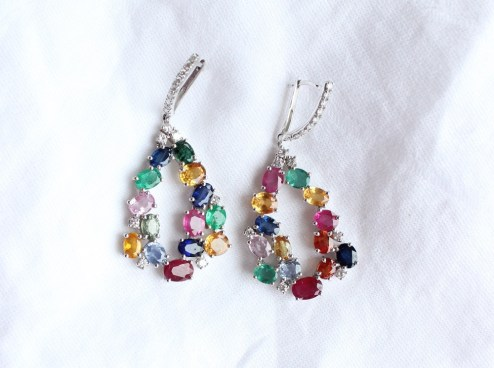 Lot 11 - Estimates: £2,000 - 3,000 . A pair of Cartier 'Tutti Frutti' style drop earrings, set with rubies, sapphires, emeralds and diamonds in a white metal setting, approximately 5cm drop x 2cm wide, approximately 17.5 grams