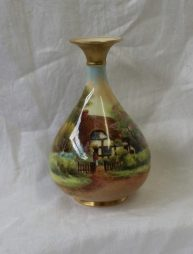 A Royal Worcester porcelain baluster vase with a flared top painted with a cottage scene titled 'Harrington', signed by Raymond Rushton, shape No. H293, puce mark and date code for 1930, 19.5cm high. Sold for £110 at Anthemion Auctions