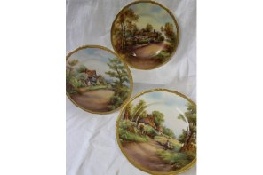Anthemion Auctions Timed auction - Lot 1059. Three Royal Worcester porcelain plates of circular ogee form, each decorated with street scenes of 'Anne Hathaways Cottage' 'Offenham' and 'Cropthorne', signed Rushton various dates, 26.8 cms diameter