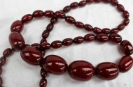A cherry amber bead necklace with graduated oval beads, 27mm to 10mm, approximately 69 grams. Sold for £200 at Anthemion Auctions