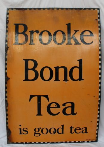 """A large enamel sign """"Brooke Bond Tea is good tea"""" with a chequer edge black script and Orange background, 152 x 101.5cm. Sold for £110 at Anthemion Auctions"""