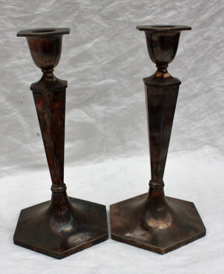 22nd August - Silver Lot 211. A pair of George VI silver candlesticks, of hexagonal tapering form on a spreading foot, Sheffield, 1949, Walker & Hall, 24.5cm high