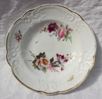 22nd August - Welsh Ceramics Lot 250. A Nantgarw porcelain bowl, painted with two floral sprays, a moth and a sprig of honeysuckle, 21cm diameter, impressed NANT-GARW CW