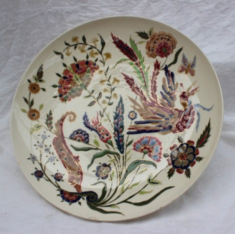 22nd August - Continental Ceramics Lot 315. A Zsolnay Pecs pottery charger, decorated with a bird of paradise amongst flowers and leaves, blue printed mark to the base, 38cm diameter