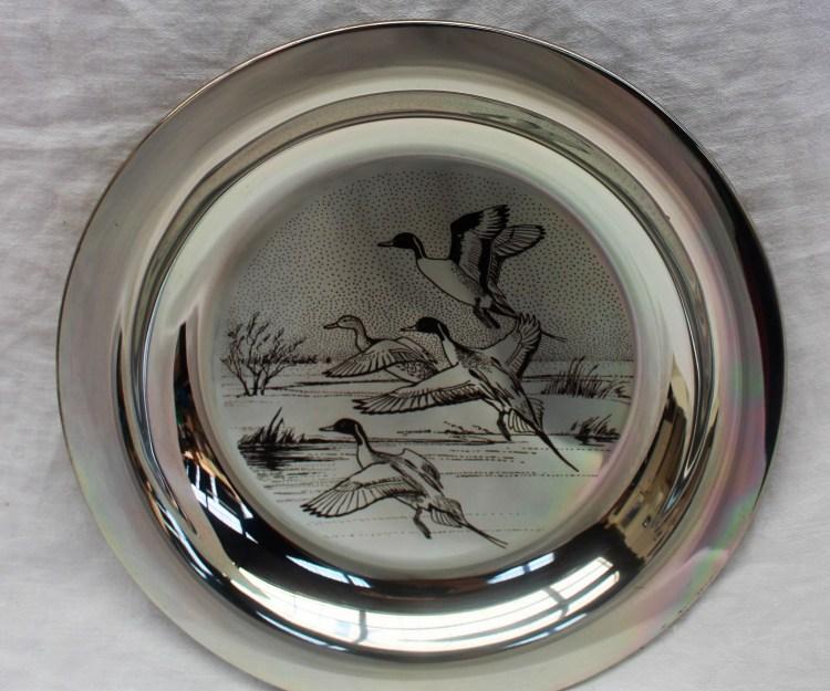 An Elizabeth II silver Peter Scott Christmas Plate 1974 – Lot 311