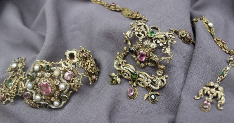 Sold for £550. An Austro Hungarian Renaissance Revival necklace, bracelet and earring set, set with amethysts and pearls with other semi precious stones to a yellow metal scrolling setting