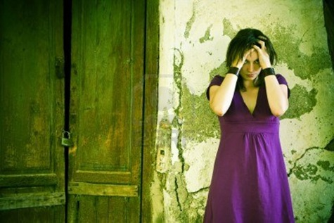 disturbed-young-woman-over-cracked-old-wall