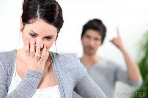 man-yelling-at-sad-woman