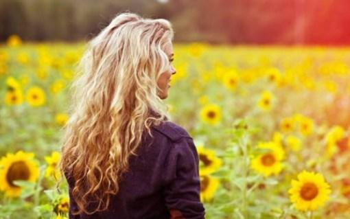 girl-smile-field-sunflowers