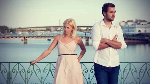 unhappy-couple-standing-on-the-bridge