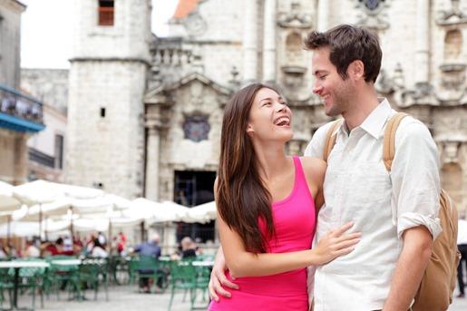 happy-tourists-couple-having-fun-during-travel-in-Plaza-de-la-Catedral-Old-Havan-cuba