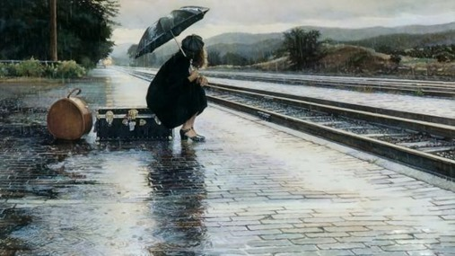 Girl-waiting-alone-in-rain-near-railway-tracks-lost-love-image