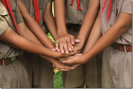 Boy scouts holding hand together in camp , strong concept about teamwork and cooperation, also refers to immigration and friendship.; Shutterstock ID 522627778