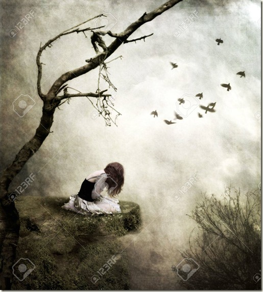 16212721-lonely-girl-sitting-on-a-rock-in-sorrow