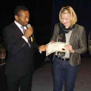 Mr Anthony-Claret Onwutalobi receiving an award from Dr Annika Forsander