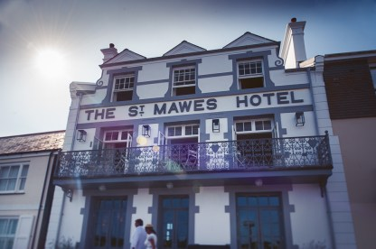 Front elevation of the St Mawes Hotel with the sun in the background and sun spots