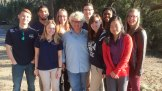 The nine students pictured with Ann Marie Adams, an IC alumna and lecturer, who hosted the team in SC.