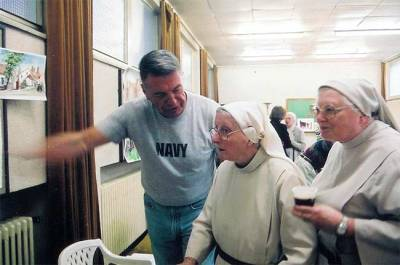 "2005. The English Convent in Bruges, Belgium. Tony shows some of his sketches to a few of the ""host"" nuns."